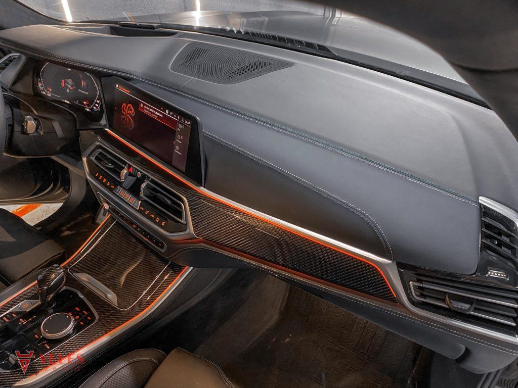 перетяжка торпедо кожей BMW